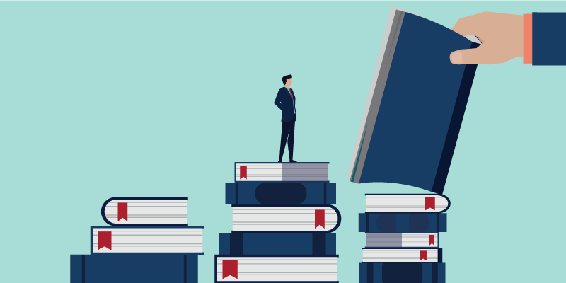illustration of a man standing on top of a mountainous pile of books